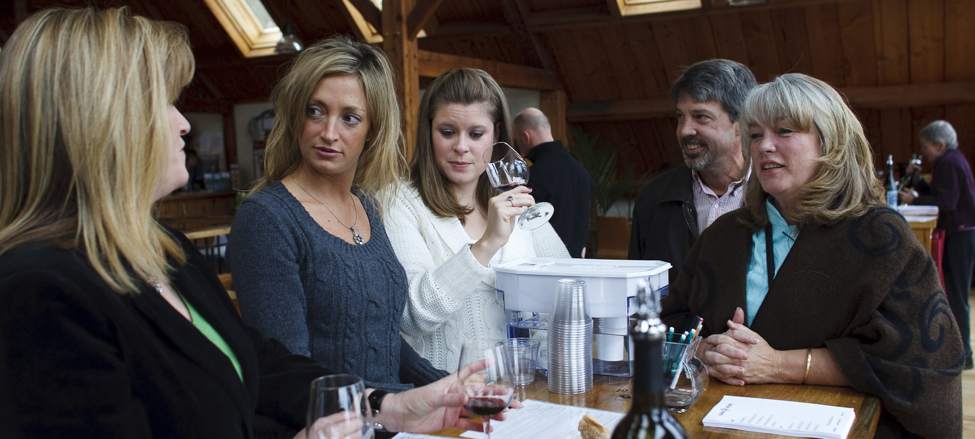 Guests with tour guides tasting popular Blenheim Vineyards local wines