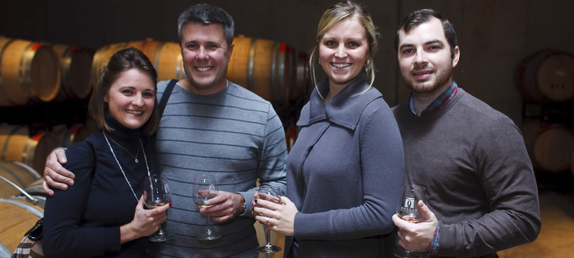 Tasting in a picturesque barrel room creates an enjoyable atmosphere